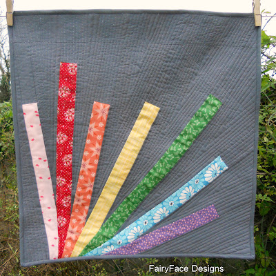 Crayon Box mini quilt finished hanging